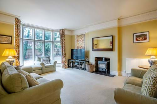 the sitting room with log burning stove in a house for sale with Chester estate agent Rickitt Partnership