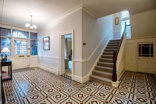 the hallway with minton tiled floor in a period house for sale in Chester